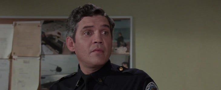 G.W Bailey, alias Thaddeus Harris, dans Police Academy.