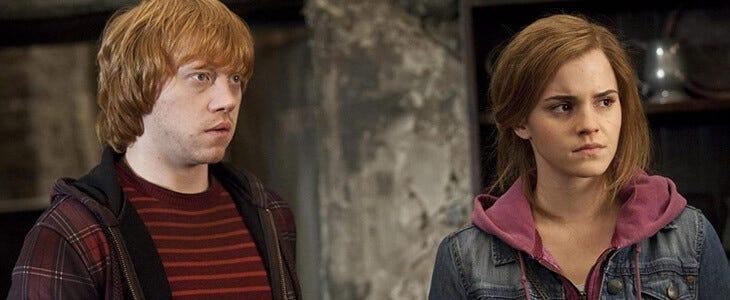 Rupert Grint et Emma Watson dans Harry Potter et les Reliques de la Mort, partie 2.